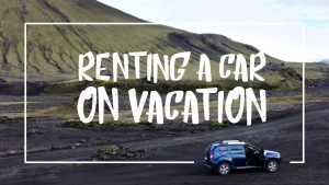 "White font on a picture of a car in Iceland reading:""Renting a car on vacation"""
